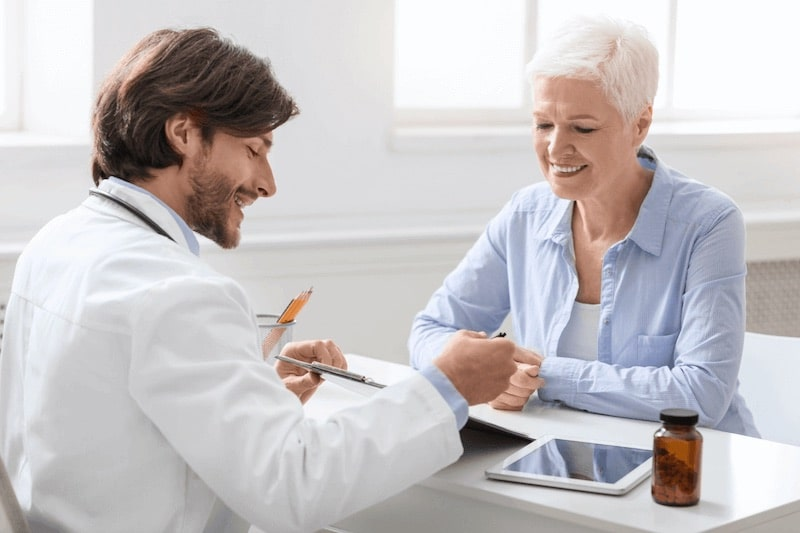 A female patient meets with her urologist