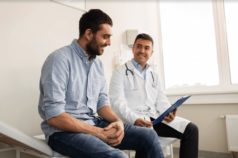 Patient talking with physician