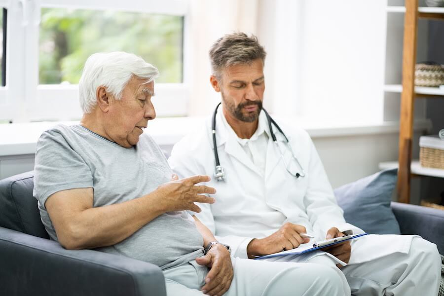 Urologist-giving-support-for-prostate-cancer-to-male-patient
